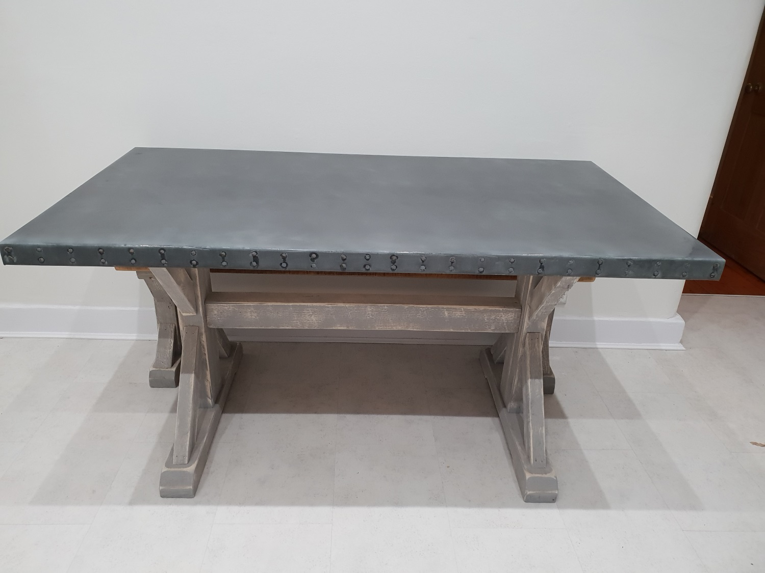 Iconic zinc table & matching bench for London home