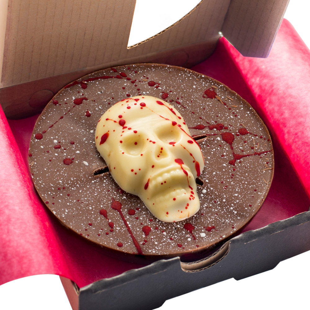 Our Mini Halloween Pizzas have been given a spooky new look for 2019 with a white chocolate skull and red splatter effect.