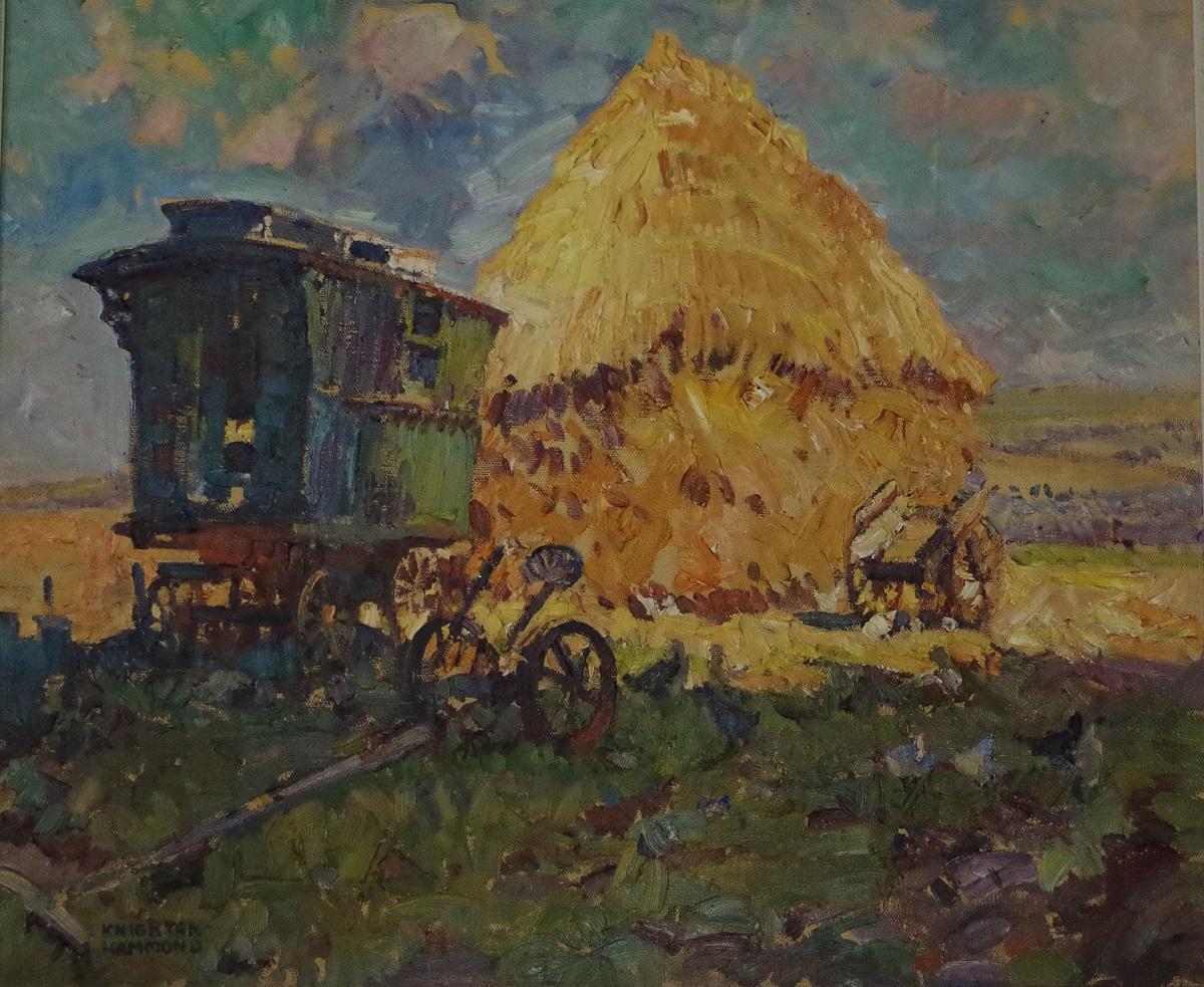 A caravan and haystack in landscape