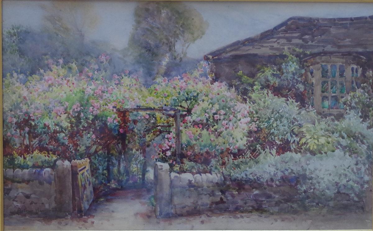 Cottage in a flower garden