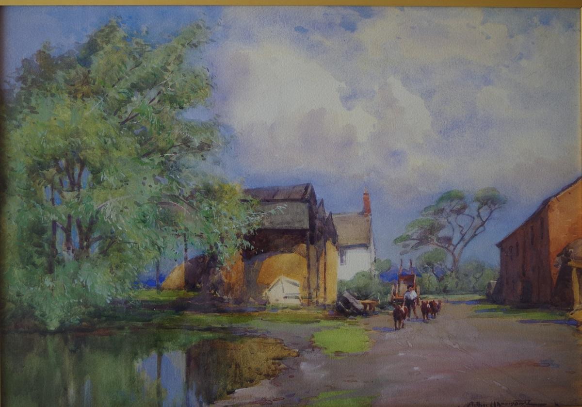 Farm buildings by a pond