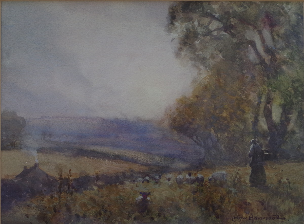 Shepherd with flock in landscape