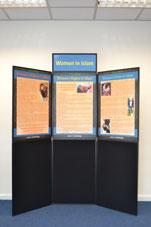 Folding display board: Women in Islam.