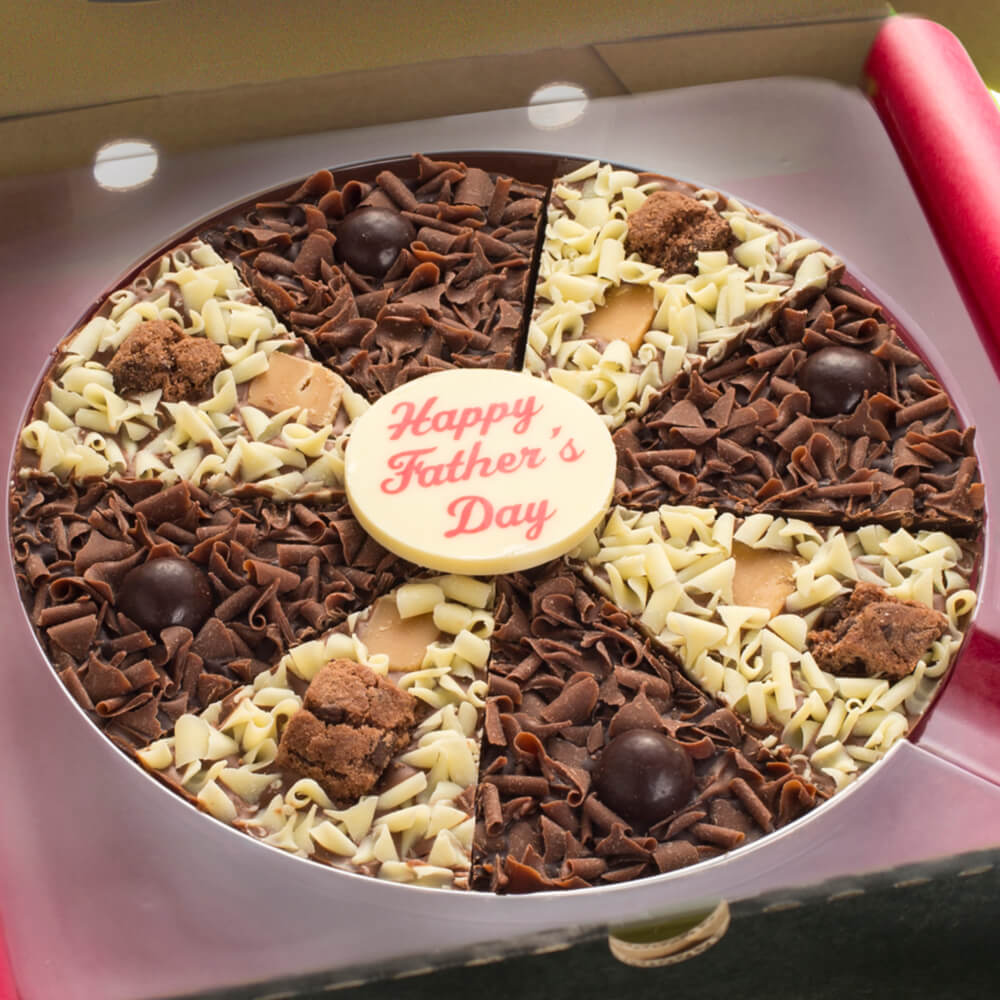 Our Father's Day Pizza offers both a milk and dark chocolate base and is topped with a mixture of milk and white curls, fudge and brownie pieces