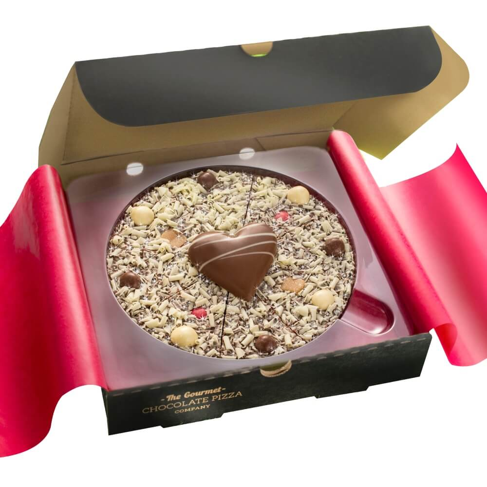"Our 7"" Valentines Pizza is presented in a stylish black pizza box with red tissue paper."
