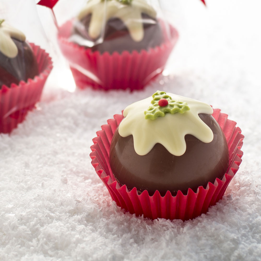 A chocolate case filled with delicious rocky road in the shape of a festive xmas pud