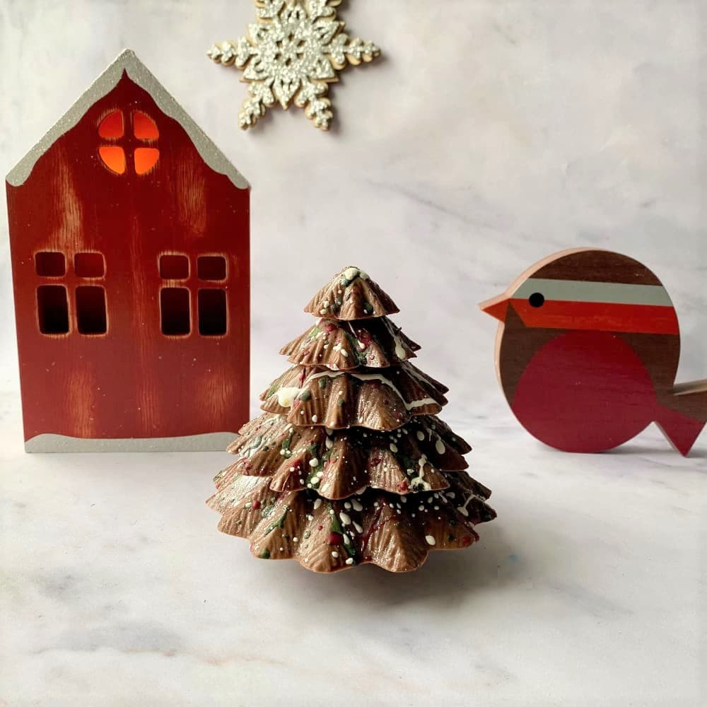 Our solid milk chocolate Christmas Tree measures approx 10cm in height and make a stunning gift for Christmas.