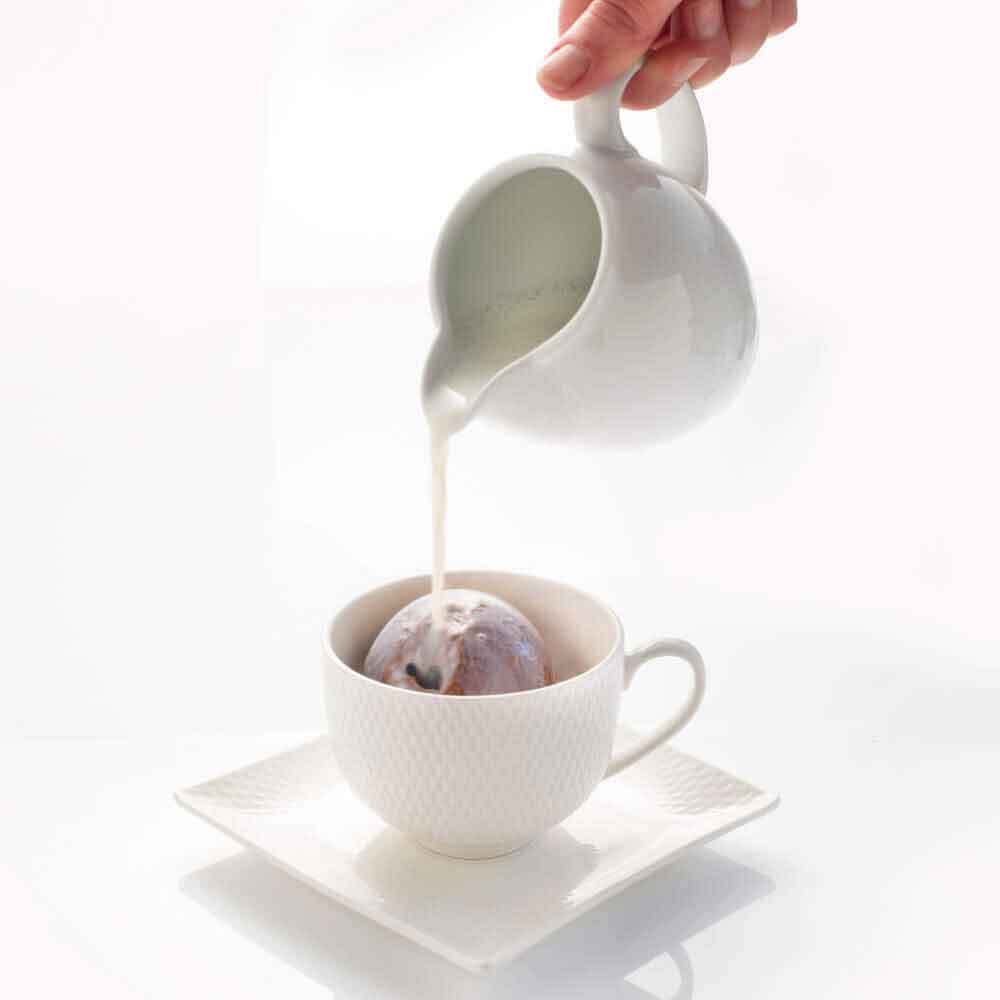 Pop a Hot Chocolate Bombe into your cup and pour over hot milk to melt.