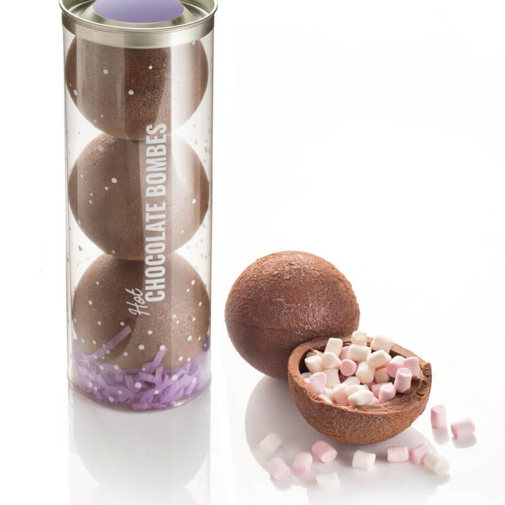 Hot Chocolate Bombes made with real Belgian milk chocolate packed with mini-marshmallows inside and dusted with edible shimmer