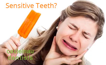 What causes sensitive teeth and how can I treat them?